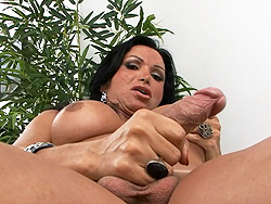 Monica masturbating. Tranny Monica stroking off her huge rough cock